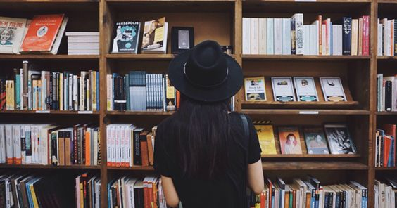 girl in front of books.jpg